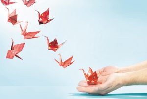 veterinary-Red-origami-cranes-flying-away-from-hands-450px-164210741